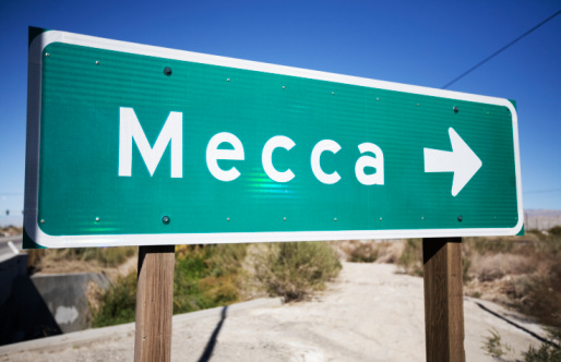 A sign pointing to Mecca